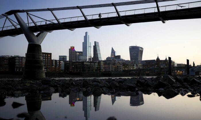 The financial district can be seen as people walk across Millennium Bridge in London, Britain, on Dec. 14, 2020. (Henry Nicholls/Reuters)