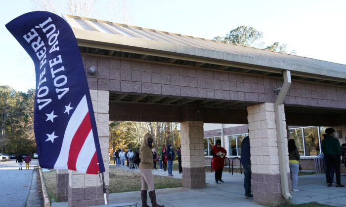 Voters stand in line to cast their ballots during the first day of early voting in the U.S. Senate runoffs at Lenora Park in Atlanta, Ga., on Dec. 14, 2020. (Tami Chappell/AFP via Getty Images)