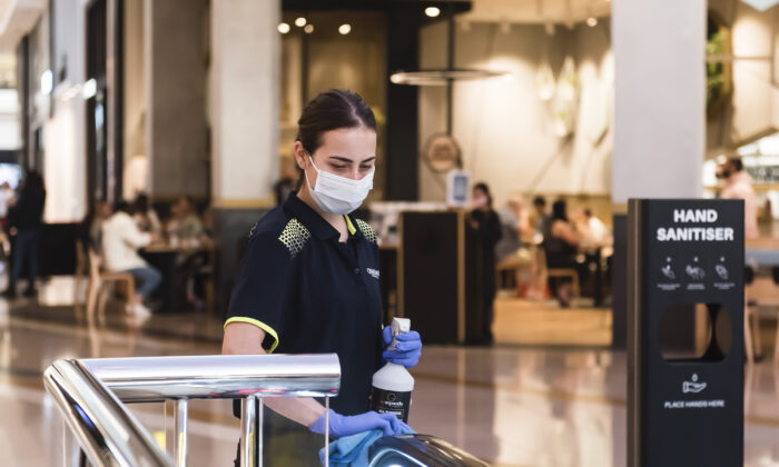 An employee maintains COVID-19 safety during the Boxing Day sales at Chadstone in Melbourne, Australia on Dec. 26, 2020. (Naomi Rahim/Getty Images)