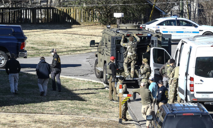Law enforcement officers investigate the house previously belonging to Anthony Quinn Warner, a 63-year-old man who has been reported to be of interest in the Nashville RV bombing, in Nashville, Tenn., on Dec. 26, 2020. (Terry Wyatt/Getty Images)