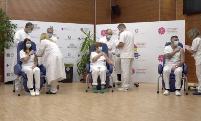Claudia Alivernini, Maria Rosaria Capobianchi, and Omar Altobelli, the first three recipients of Pfizer/BioNTech COVID-19 vaccine in Italy, receives their vaccination at the Spallanzani hospital in this screengrab taken from a video, in Rome, Italy on Dec. 27, 2020. (Ministero della Salute/Handout via Reuters)