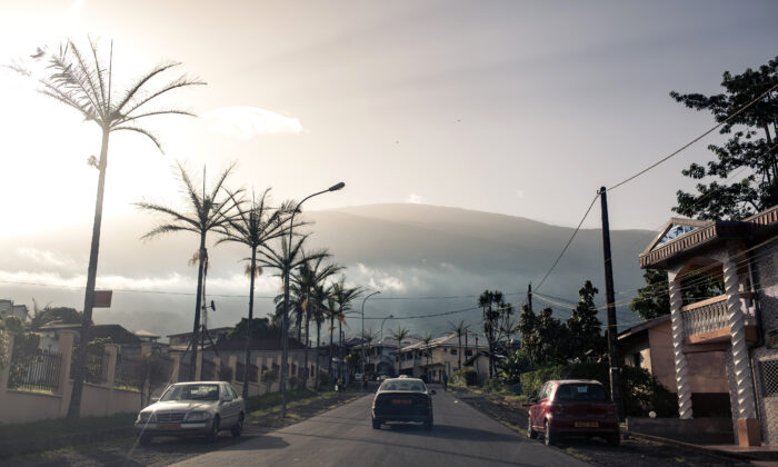 A car drives on a street of Buea, South-West Region of Cameroon, on April 26, 2018. (Alexis Huguet/AFP via Getty Images)