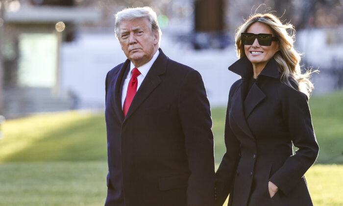President Donald Trump and First Lady Melania Trump walk on the south lawn of the White House in Washington on Dec. 23, 2020. (Tasos Katopodis/Getty Images)