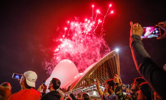 Fireworks explode over the Sydney Harbour Bridge and Sydney Opera House during the midnight display during New Year's Eve celebrations in Sydney, Australia on Jan. 1, 2020. (Hanna Lassen/Getty Images)