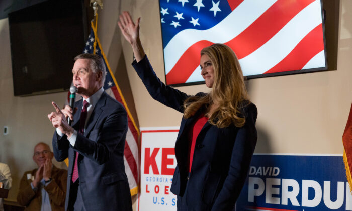 Sens David Perdue (R-Ga.) and Kelly Loeffler (R-Ga.) at a campaign event at a restaurant in Cumming, Ga., on Nov. 13, 2020. (Megan Varner/Getty Images).