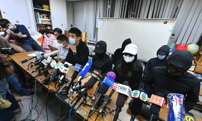 Family members of 12 Hong Kong residents detained in mainland China hold a press conference in Hong Kong on Dec. 28, 2020. (Song Bilung/The Epoch Times)
