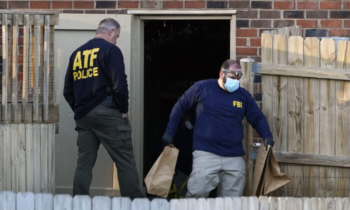 FBI and ATF agents investigate a home connected to the Christmas Day bombing, in Nashville, Tenn., on Dec. 26, 2020. (Mark Humphrey/AP Photo)