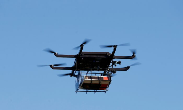 A drone demonstrates delivery capabilities from the top of a UPS truck during testing in Lithia, Fla, on Feb. 20, 2017. (Scott Audette/Reuters, File Photo)