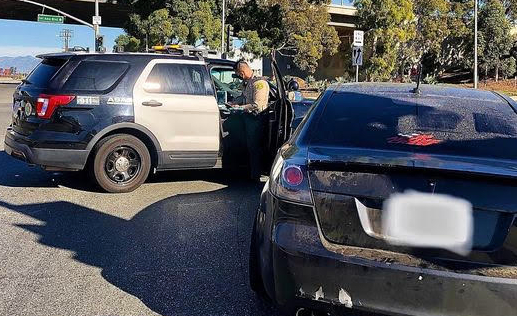 A Los Angeles County Sheriff's Department deputy responds to an illegal street racing accident that killed a spectator in Carson, Calif., on Dec. 25, 2020. (Courtesy of the Los Angeles County Sheriff's Department)