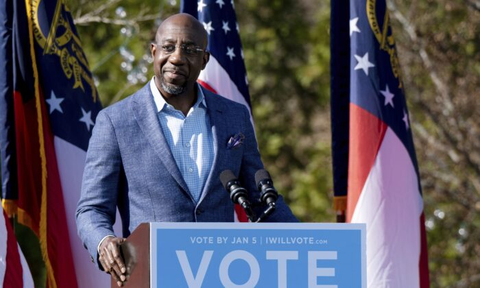 Georgia Democratic Senate candidate Rev. Raphael Warnock addresses the crowd during a drive-in rally at Bibb Mill Event Center in Columbus, Ga., on Dec. 21, 2020. (Ben Gray/AP Photo)