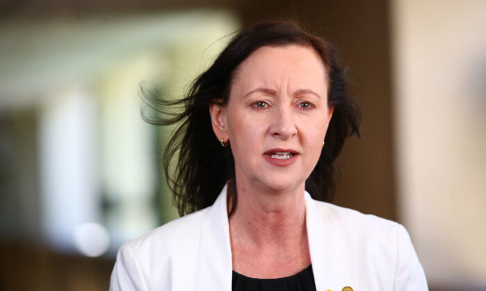 Attorney General Yvette D'Ath speaks during a press conference at Parliament house in Brisbane on Aug. 22, 2019. (AAP Image/Jono Searle)