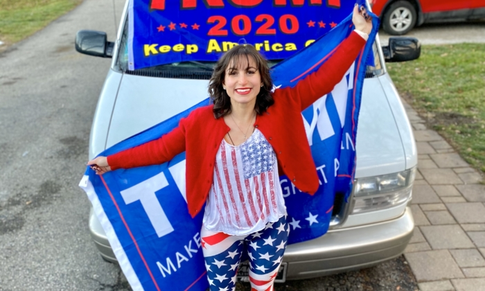 Amelia, 22, of Fenton, Michigan, poses for a photo in front of a car decorated with a Trump flag. (Courtesy Photo)