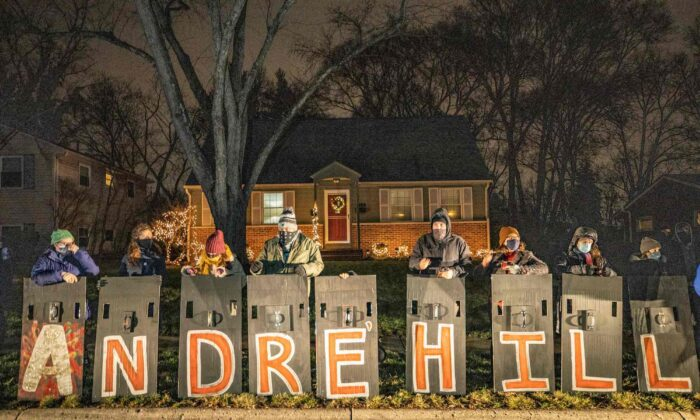 People hold signs spelling the name of Andre Hill, who was shot and killed by a police officer last week, as they participate in a demonstration in Columbus, Ohio, on Dec. 28, 2020. (Stephen Zenner/AFP/Getty Images)