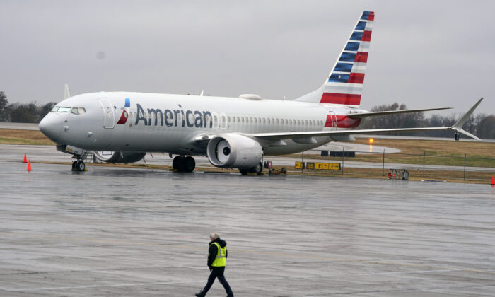 In this Dec. 2, 2020 file photo, an American Airlines Boeing 737 Max jet plane is parked at a maintenance facility in Tulsa, Okla.  Paying passengers were scheduled to board a Boeing 737 Max in Miami on Tuesday, Dec. 29 for the first time since safety regulators allowed the plane to fly again after two deadly crashes.