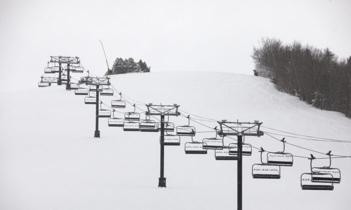 Idle chairlifts are seen on the shut-down slopes of Blue Mountain Ski Resort in The Blue Mountains, Ontario, Canada, on Dec. 26, 2020. (Cole Burston/The Canadian Press)