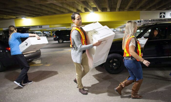 Election workers unload ballot boxes at City Hall in London, Ont., during the Ontario municipal elections on Oct. 22, 2018. (The Canadian Press/ Geoff Robins)