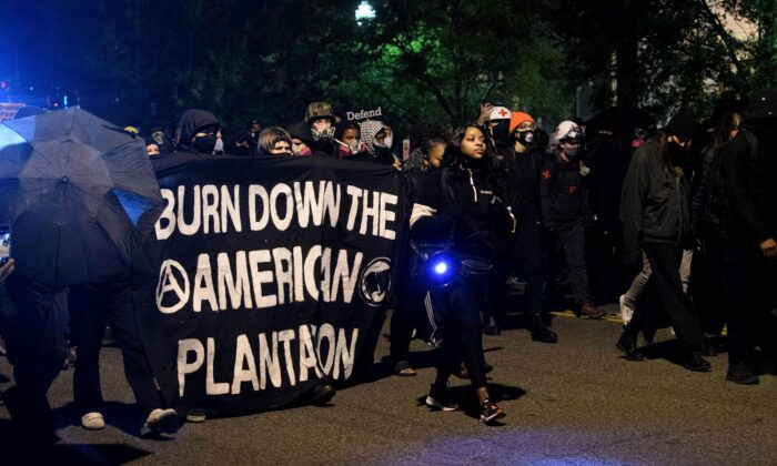 Antifa and Black Lives Matter demonstrators protest on election night near the White House in Washington on Nov. 3, 2020. (Nicholas Kamm/AFP via Getty Images)