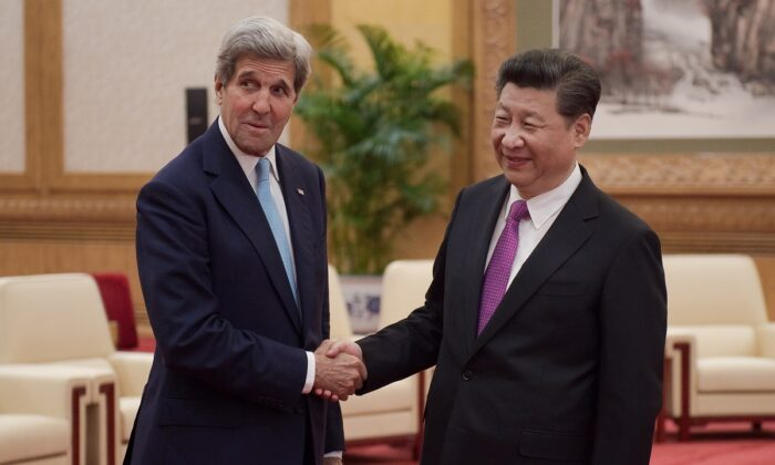 The then-U.S. Secretary of State John Kerry (L) shakes hands with Chinese leader Xi Jinping (R) at the Great Hall of the People at the end of the eighth round of U.S-China strategic and economic dialogues in Beijing, China on June 7, 2016. Kerry was in China for talks on a variety of issues including seeking diplomatic solutions for the South China Sea. (Nicolas Asfouri - Pool/Getty Images)