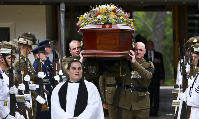 Members of the Australian Defence Force carry the coffin during a State funeral for Major General Michael Jeffery at the ANZAC Memorial Chapel of St Paul, Duntroon, Canberra, on Dec. 29, 2020. (Lukas Coch/AAP)