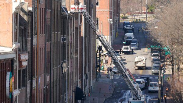 Firefighters inspect buildings in Nashville