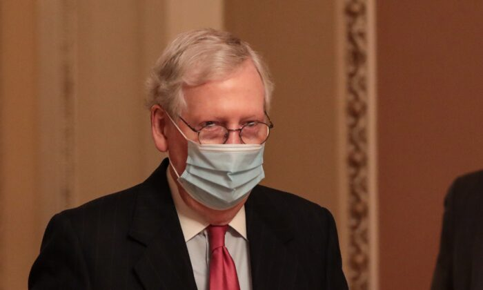 Senate Majority Leader Mitch McConnell (R-Ky.) walks in Washington on Dec. 21, 2020. (Cheriss May/Getty Images)