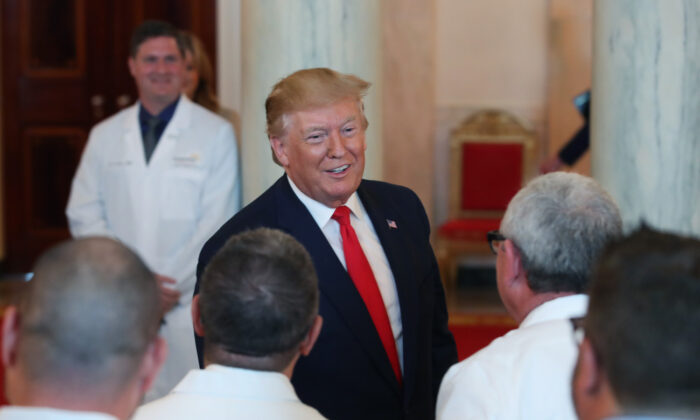 President Donald Trump greets healthcare workers after signing an executive order intended to improve quality and price transparency in healthcare during an event in the Grand Foyer of the White House in Washington, on June 24, 2019. (Mark Wilson/Getty Images)