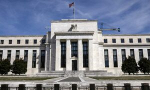 Fed Holds Interest Rates Near Zero, Boosts Inflation Forecast