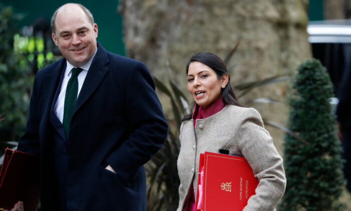 Britain's Home Secretary Priti Patel (R) and Defence Secretary Ben Wallace (L) arrive for a cabinet meeting at 10 Downing Street in central London on Feb. 14, 2020. (Tolga Akmen/AFP via Getty Images)