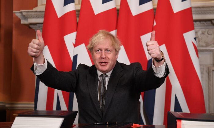 Britain's Prime Minister Boris Johnson gives a double thumbs up after signing the Trade and Cooperation Agreement between the UK and the EU, the Brexit trade deal, at 10 Downing Street in central London on Dec. 30, 2020. (Leon Neal/Pool/AFP via Getty Images)