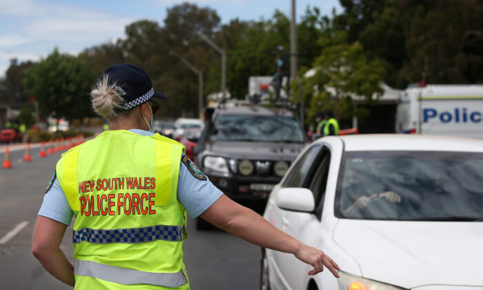 NSW police patrolling the Victorian border checkpoint in South Albury, Australia on November 22, 2020. (Lisa Maree Williams/Getty Images)