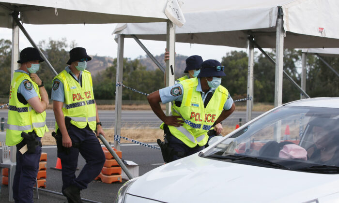 NSW police stop vehicles at the Hume Highway checkpoint at the Victorian border in Albury, Australia on November 22, 2020. (Lisa Maree Williams/Getty Images)