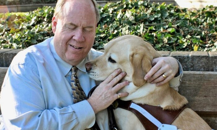 Michael Hingson with his guide dog Roselle. (Courtesy of Michael Hingson)