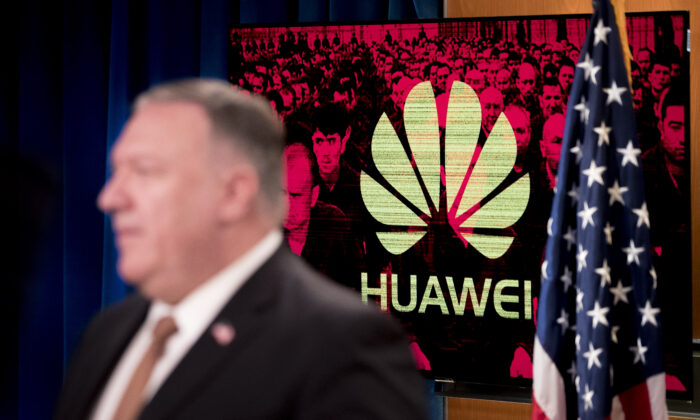 A monitor displays the Huawei logo behind Secretary of State Mike Pompeo during a news conference at the State Department in Washington on July 15, 2020. (ANDREW HARNIK/POOL/AFP via Getty Images)