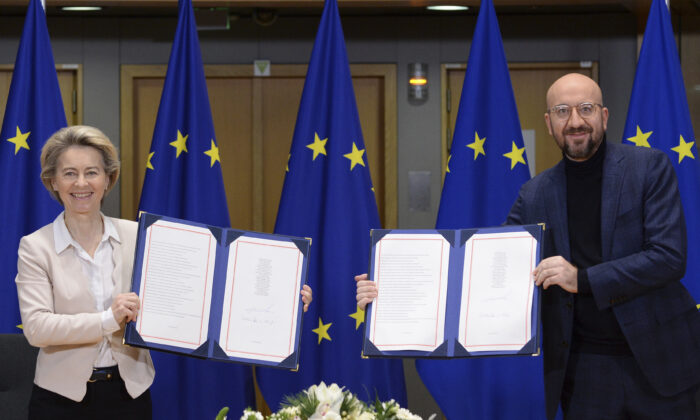 European Commission President Ursula von der Leyen and European Council President Charles Michel show signed EU-UK Trade and Cooperation Agreements at the European Council headquarters in Brussels on Dec. 30, 2020. (Johanna Geron/Pool Photo via AP)