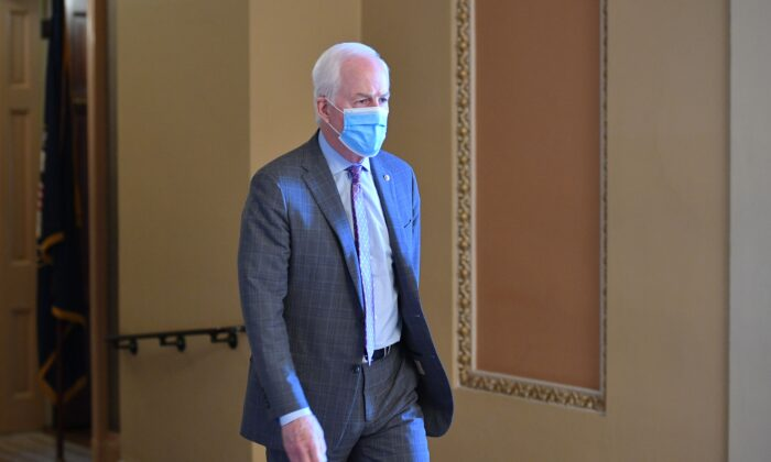 Sen. John Cornyn (R-Texas) walks in Washington on Dec. 8, 2020. (Mandel Ngan/AFP via Getty Images)