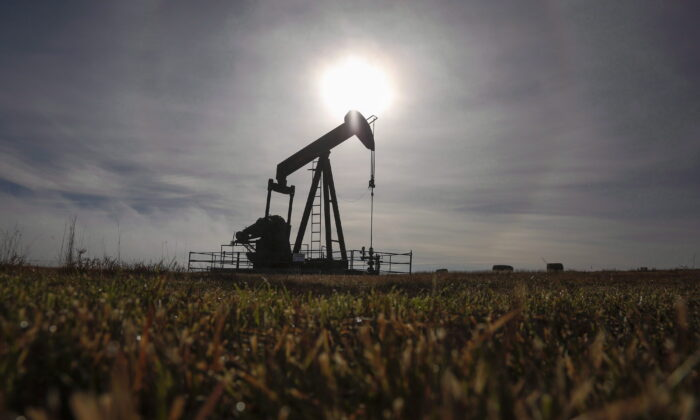 A pumpjack works at a well head on an oil and gas installation near Cremona, Alta., in a file photo. (The Canadian Press/Jeff McIntosh)