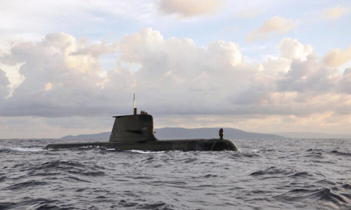 The Royal Australian Navy Collins Class Submarine HMAS Sheean passes Christmas Island on her way to Singapore for a major regional exercise (ABPH Joanne Edwards/ Supplied)