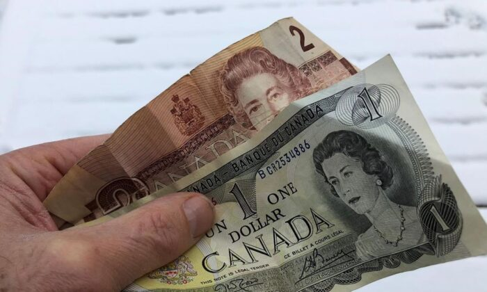 Old one and two dollar bills are shown in Oakville, Ont. on Dec. 30, 2020. (The Canadian Press/Richard Buchan)