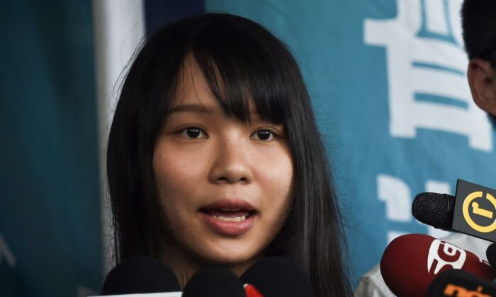 Pro-democracy activist Agnes Chow speaks to the press after she was released on bail at the Eastern Magistrates Courts in Hong Kong on August 30, 2019. (Lillian Suwanrumpha/AFP via Getty Images)