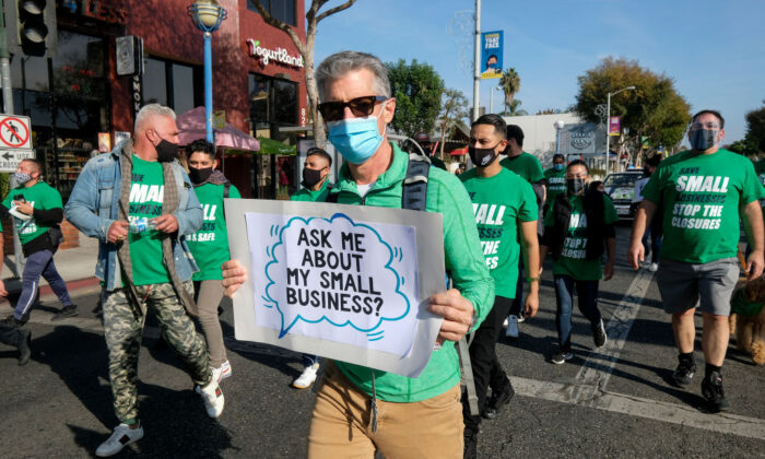 Small business owners and their supporters participate in a Save Small Business protest in Los Angeles, Calif., on Dec. 12, 2020. (Ringo Chiu/AFP via Getty Images)