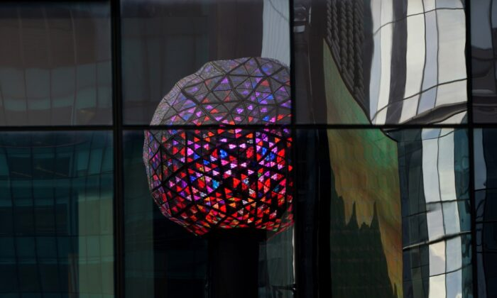 The Times Square ball is reflected in a nearby building as it is tested out for the media ahead of the New Year's celebration in Times Square of New York City, N.Y., on Dec. 30, 2020. (Carlo Allegri/Reuters)