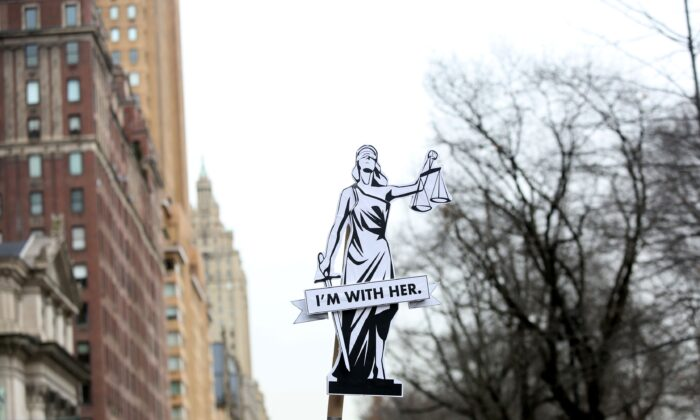 "A sign reads ""I'm with her"" as people participate in the annual Women's March on Jan. 18, 2020 in New York City. (Yana Paskova/Getty Images)"