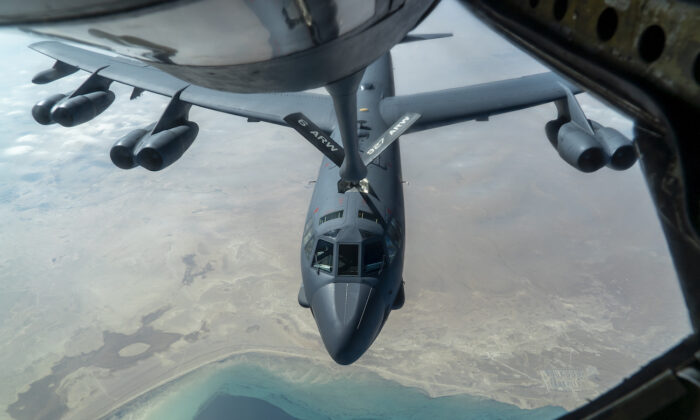 A U.S. Air Force B-52 from Barksdale Air Force Base is aerial refueled by a KC-135 Stratotanker over the U.S. Central Command area of responsibility Dec. 30, 2020. (U.S. Air Force photo by Senior Airman Roslyn Ward)