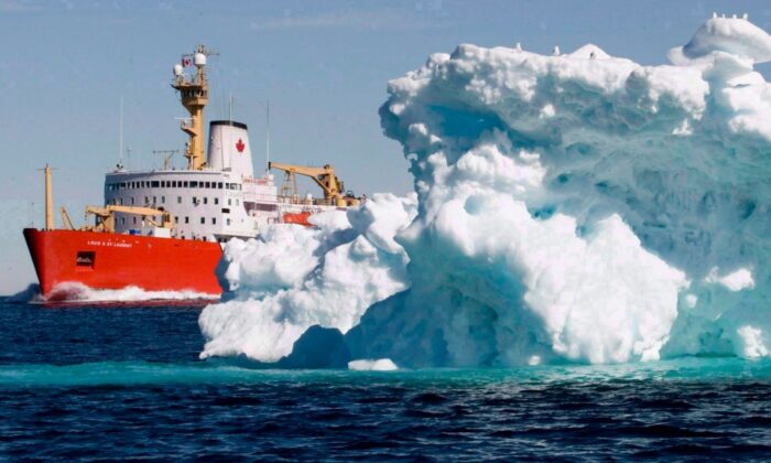 The Canadian Coast Guard icebreaker Louis S. St-Laurent sails past an iceberg in Lancaster Sound on July 11, 2008. (The Canadian Press/Jonathan Hayward)
