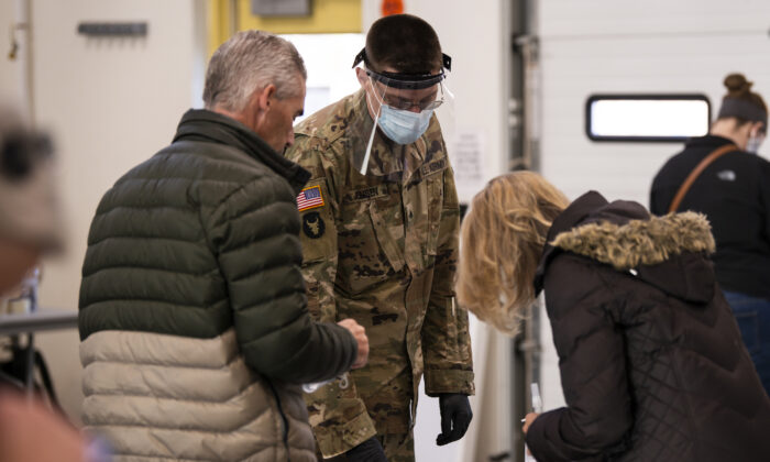 Minnesota National Guards assist residents at a COVID-19 testing facility in the Stillwater Armory National Guard Center in Stillwater, Minnesota on December 10, 2020.  (Stephen Maturen/Getty Images)