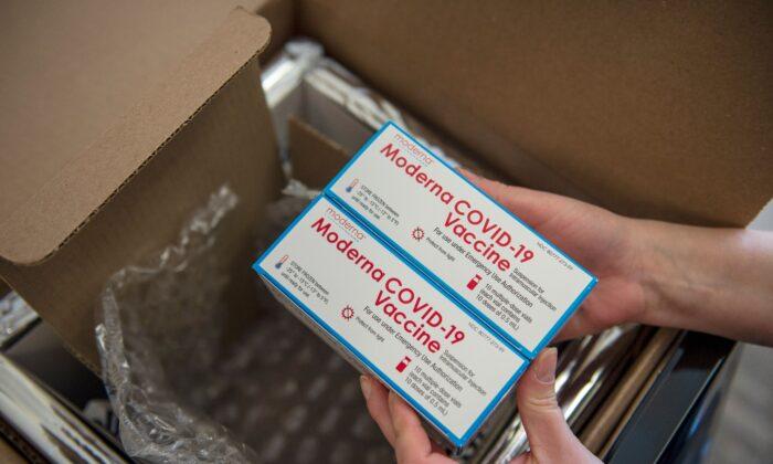 Moderna COVID-19 vaccines are unpacked in Boston, Mass., on Dec. 24, 2020. (Joseph Prezioso/AFP via Getty Images)