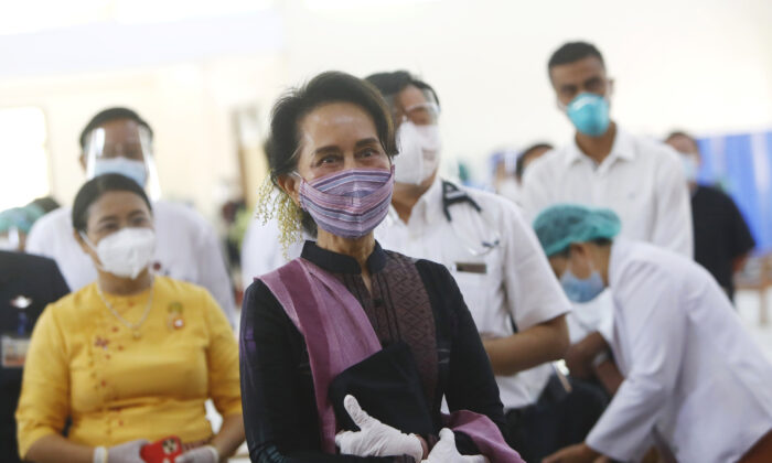 Burma's leader Aung San Suu Kyi is seen as she inspects and watches the vaccination processes to health workers at hospital in Naypyitaw, Burma on Jan. 27, 2021. (Aung Shine Oo/AP Photo)