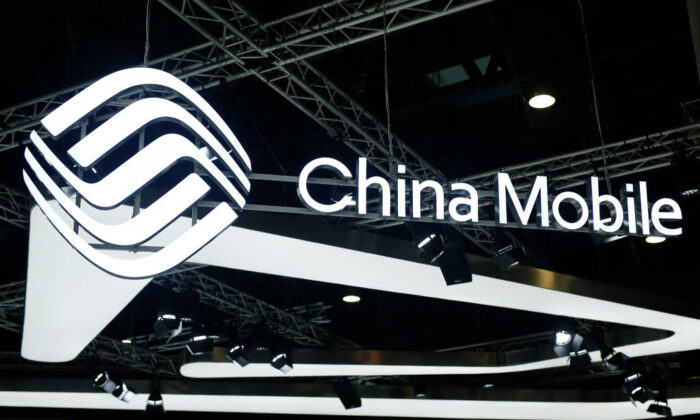 The China Mobile logo is displayed at the Mobile World Congress in Barcelona, Spain, on Feb. 26, 2019. It is one of three Chinese telecom firms that will be delisted from the New York Stock Exchange. (Pau Barrena/AFP via Getty Images)