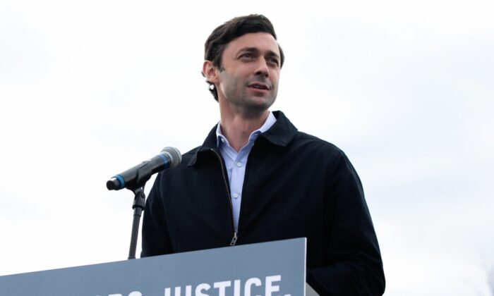 """Georgia Democratic Senate candidate Jon Ossoff speaks to the crowd during a """"It's Time to Vote"""" drive-in rally on Dec. 28, 2020 in Stonecrest, Georgia. (Jessica McGowan/Getty Images)"""