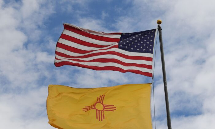 The U.S. and New Mexico flags fly in Albuquerque, NM, on Oct. 1, 2018. (Mark Ralston/AFP/Getty Images)